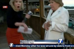 A TV video frame grab courtesy of WDBJ7-TV in Roanoke, Virginia, showing journalist Alison Parker (left) the moment shots ring out during her interview on tourism with Ms Vicki Gardner, the local chamber of commerce director.