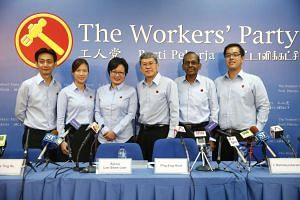 WP chairman Sylvia Lim (third from left) and Mr Png Eng Huat (third from right) introduced new candidates Adrian Sim Tian Hock (left), He Ting Ru (second from left), L. Somasundaram (second from right), and Ron Tan Jun Yen (right) on Aug 28, 2015.