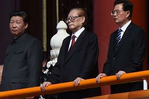 Chinese President Xi Jinping (left) with former presidents Jiang Zemin (centre) and Hu Jintao (right) attend the military parade at Tiananmen Square in Beijing on Sept 3, 2015.