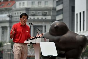 SDP chief Chee Soon Juan speaking at his party's lunchtime rally outside UOB Plaza in Raffles Place.