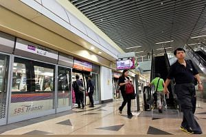 Commuters alighting at Woodleigh MRT station.