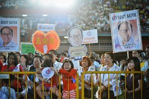 PAP supporters at a rally at Jurong East Stadium on Sept 7, 2015.