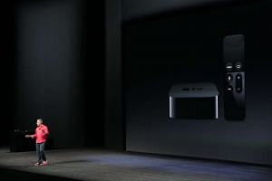 The Apple TV's design remains unchanged but it is thicker and now comes with a remote that doubles as a game controller.