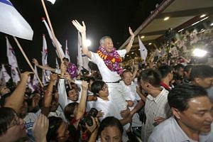 """PM Lee being lifted by supporters at Toa Payoh Stadium. He said in a speech after winning Ang Mo Kio GRC that his team was very grateful for the support and that """"SG100 will be better than SG50""""."""