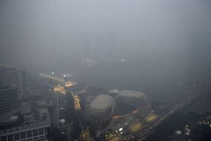 The view from the 65th floor of Swissotel The Stamford as the haze blankets the Esplanade and the Marina Bay area at about 7pm on Sept 14, 2015.