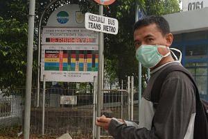 "A board in Pekanbaru in Riau province displaying the air quality as ""berbahaya"" or ""dangerous"", on Sunday."