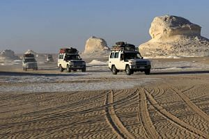 Four-wheel drive cars cross the sand dunes in the Egyptian western desert and the Bahariya Oasis, southwest of Cairo in picture taken on May 15.