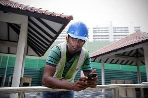Environmental control officer Ganesh Kumar, who works at a Braddell Road construction site, checks the PSI level on the National Environment Agency website every hour and alerts supervisors if it goes above 200.