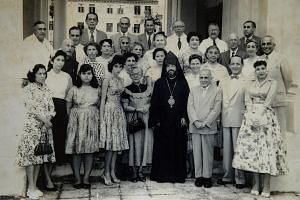 A younger Madam Loretta Sarkies (fourth from left in the front row) is seen in this picture taken with members of the Armenian community here in the 1950s, with a priest who was making a rare visit to Singapore. Her younger sister Jessica is to her r