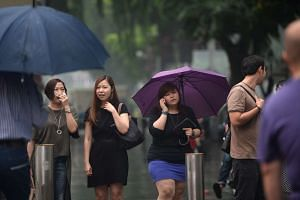 People carrying umbrellas along Orchard Road on Sept 15, 2016. As of 9am on Thursday (Sept 17), the three-hour PSI, an indicative reading not tied to health advisory, was 62.