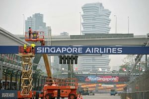 Workers setting up the race track for the Singapore Grand Prix on Sept 16. The haze situation has since improved, with the 24-hour PSI in the moderate range on Friday morning.
