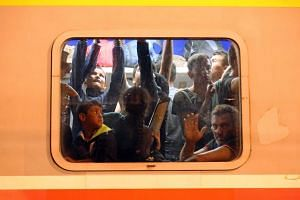 Migrants waiting in a train in the eastern-Croatia town of Tovarnik, close to the border between Croatia and Serbia, on Sept 18, 2015.