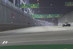 A man venturing briefly onto the track during the Singapore Grand Prix on Sept 20, 2015.