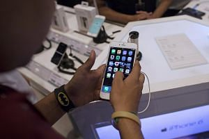A man inspecting the Apple iPhone 6 Plus at an electronics store in India, on July 23, 2015.