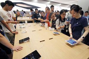 Customers visiting an Apple shop in Nanjing, China.