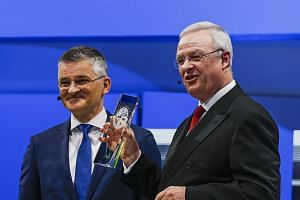 "MR MICHAEL HORN (left), chief executive of Volkswagen Group of America. He is standing with VW chairman and CEO Martin Winterkorn, who is holding the ""North American Car of the Year"" award - presented for the VW Golf TDI - at the North American Inter"