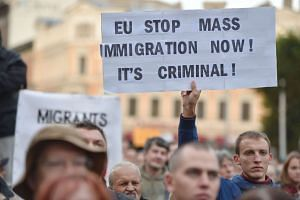 People protest against the arrival of migrants in Latvia.