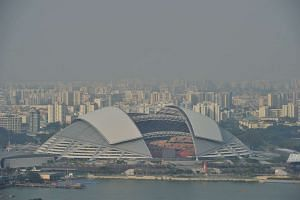 The Sports Hub shrouded in haze in this Aug 20, 2015 file photo.