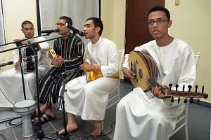 This band of Arabs comprising (from left) Abu Bakar Alwee Alsree, 24; Muhammad Hussein Alhindwan, 35; Agil Muhamad Ba'Arfan, 26; and Izzat Adnan Bin Afif, 21, performs with traditional Arab musical instruments. It was Alwehdah's main contribution to