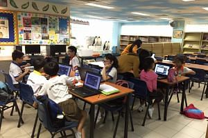 Students from Si Ling Primary School being housed at the library due to the haze situation on Sept 25, 2015.