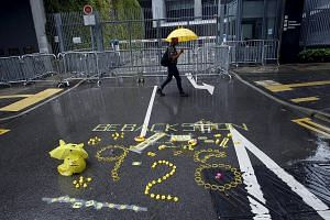 "A sign with the numbers ""928"" left by pro-democracy activists on the road outside government headquarters in Hong Kong. Next Monday is the first anniversary of the Occupy Central civil disobedience movement, which started on Sept 28 last year."