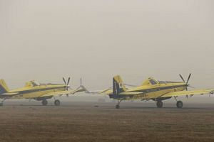 Australian water bombing aircraft are seen waiting for improved visibility at Palembang airport in Palembang, south Sumatra, on Sept 28, 2015.