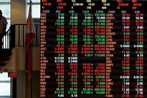 An electronic board showing prices on the Philippine Stock Exchange in Manila.