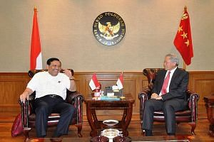 Dr Ng Eng Hen (right) calling on Indonesia's Coordinating Minister for Political, Legal and Security Affairs Luhut Panjaitan on Monday. During the talks, Dr Ng raised the SAF's offer to help Indonesia deal with forest fires.