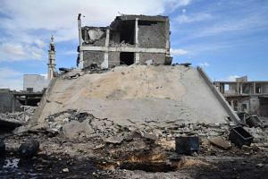 Damaged buildings and a minaret in the central Syrian town of Talbisseh in the Homs province on Sept 30, 2015.
