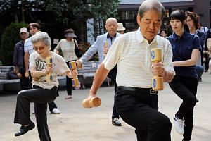 A group of seniors exercising in Tokyo. A 2011 study in Britain found that, after deducting pensions, welfare and healthcare, older people contributed £44 billion (S$95 billion) to society in terms of taxes and spending, among other things.