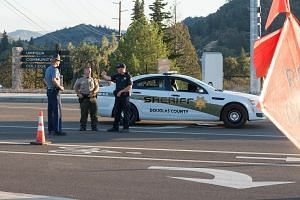 A police car blocking a road in Roseberg, Oregon, on Oct 1, 2015, after a gunman went on a shooting rampage earlier in the day.