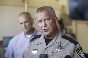Douglas County Sheriff John Hanlin vowed never to utter the gunman's name.