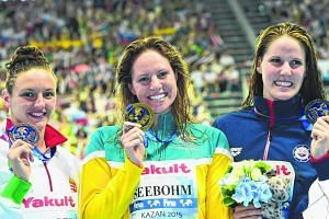 (From left) Katinka Hosszu, Emily Seebohm and Missy Franklin at the Fina World Championships in Kazan on Aug 8. Their showdown in Singapore has been cancelled due to haze.