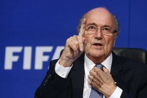 FIFA President Sepp Blatter gestures during a news conference after the Extraordinary FIFA Executive Committee Meeting at the FIFA headquarters in Zurich, Switzerland in a July 20, 2015 file photo.