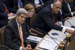 US Secretary of State John Kerry, United States Ambassador to the United Nations Samantha Power and Egyptian Foreign Minister Sameh Shoukry attend a High-Level Meeting on Libya during the United Nations General Assembly at the United Nations in Manha