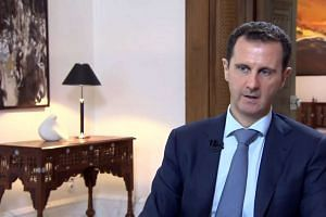 Syrian President Bashar al-Assad speaking during an interview in Damascus broadcast by Khabar TV, in a screengrab from the news channel of the Islamic Republic of Iran Broadcasting (IRIB).