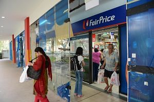 Shoppers at an NTUC Fairprice outlet in Rivervale Plaza.