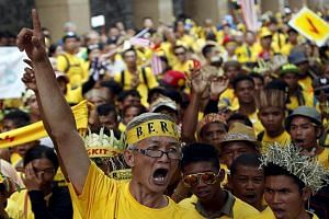 A Bersih supporter leading a group of Orang Asli - indigenous people - to Dataran Merdeka in Kuala Lumpur on Aug 30. Despite a sprinkling of other races, the anti-government demonstrations were predominantly Chinese affairs. PAS, which had joined pre