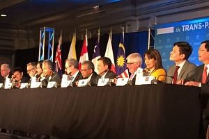 Ministers from the 12 TPP countries announcing the landmark trade deal.