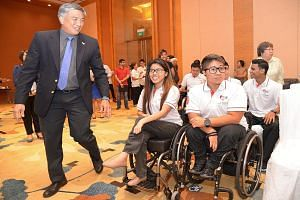 Singapore Asean Para Games Organising Committee chairman Lim Teck Yin (left) with athletes (from right) Muhammad Mubarak, Theresa Goh, Jason Chee (background) and Yip Pin Xiu at an event in August last year. While public trains will be the preferred