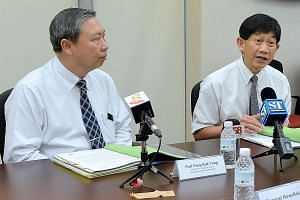(From left) Professors Fong Kok Yong and Ang Chong Lye at a media briefing on Tuesday. SGH has promised to pay for all the treatment that patients who were infected with hepatitis C at the hospital's renal ward will need to overcome it.