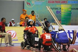 Nurulasyiqah Mohd Taha, a full-time boccia athlete who has spinal muscular atrophy, competing at last year's Asean Para Games in Myanmar, where she won two gold medals. She hopes for some leeway from the organisers if athletes are delayed while takin