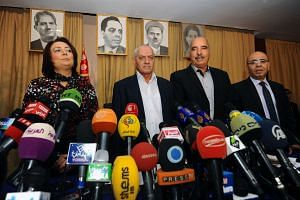 Tunisian mediators (from left) Wided Bouchamaoui, Houcine Abbassi, Abdessattar ben Moussa and Mohamed Fadhel Mahmoud in 2013.