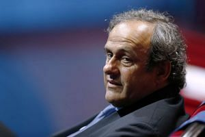 "Platini slammed the ""farcical"" Fifa ban against him."