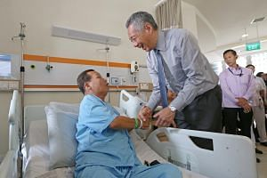 PM Lee was speaking to the media after the official opening of the Ng Teng Fong General Hospital and Jurong Community Hospital on Oct 10, 2015.