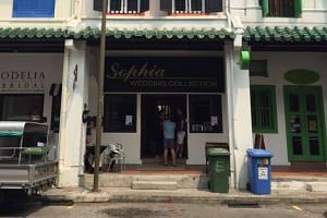 Sophia Wedding Collection's office along Amoy Street. Customers who visited it on Saturday evening found it dark and empty.
