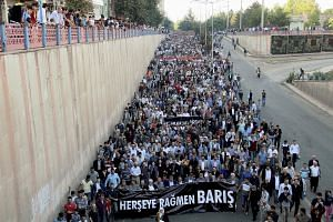 People march to protest the double suicide bombing in Ankara that killed up to 128 people in Diyarbakir, Turkey, on Oct 11, 2015.