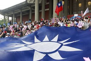 Supporters of Taiwan's ruling Nationalist Kuomintang Party (KMT) cheer during the party congress in Taipei, Taiwan, on July 19, 2015.