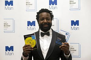 Marlon James, author of A Brief History Of Seven Killings, posing for photographers after winning the Man Booker Prize for Fiction 2015 in London on Oct 13, 2015.