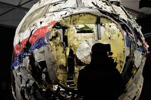 The wrecked cockipt of the Malaysia Airlines flight MH17 is presented to the press during a presentation of the final report on the cause of the its crash.